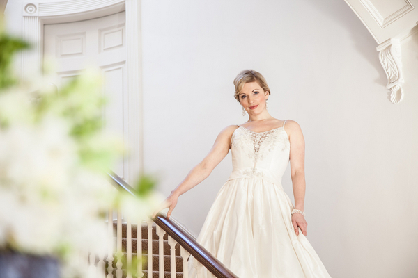 Bride standing on stairs