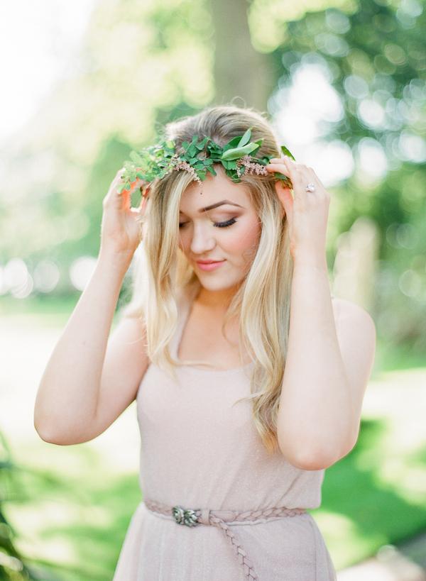 Woman adjusting leaf crown