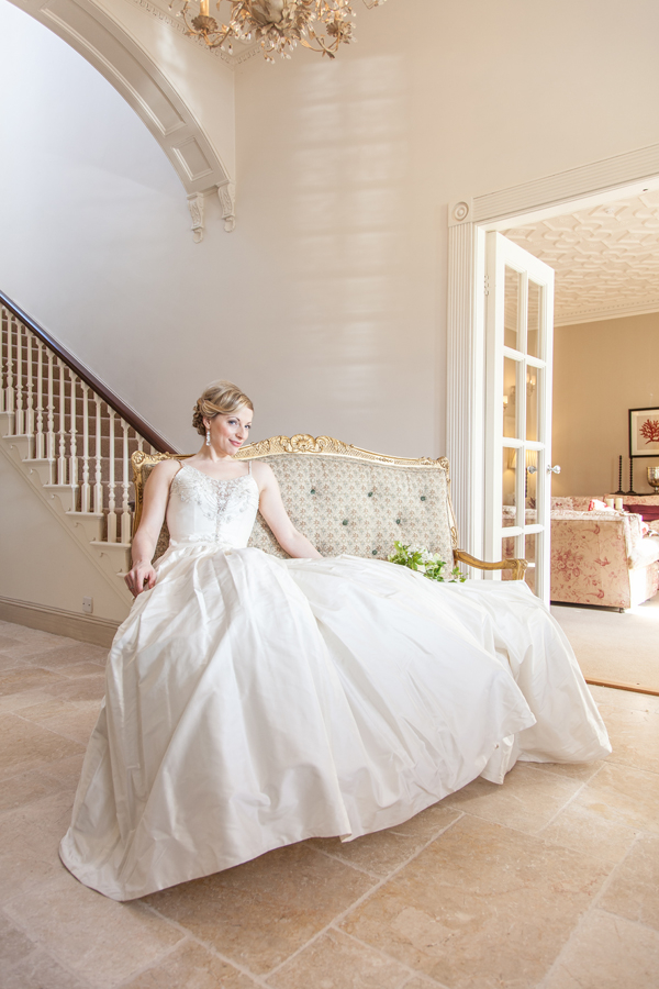 Bride sitting on chaise longue