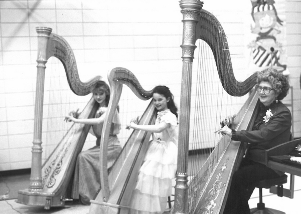 Young Michelle Dalton playing the harp