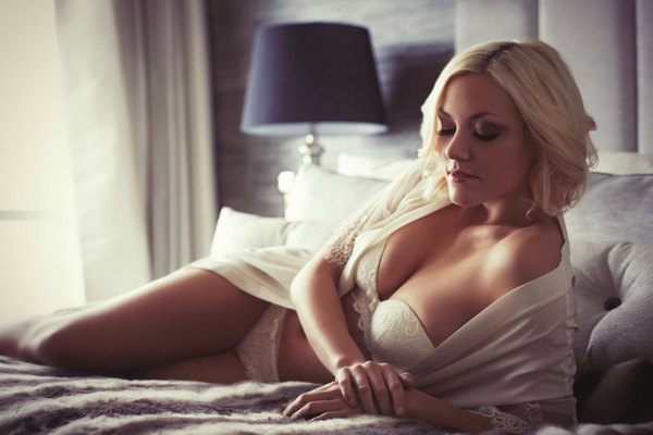 Woman in underwear laying on bed - Bridal boudoir shoot