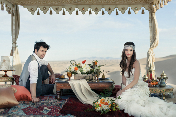 Bride and groom sitting at Moroccan style table