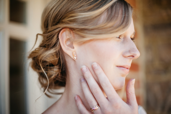 Bride with hand on face