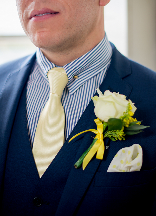 Groom's striped blue shirt and yellow tie
