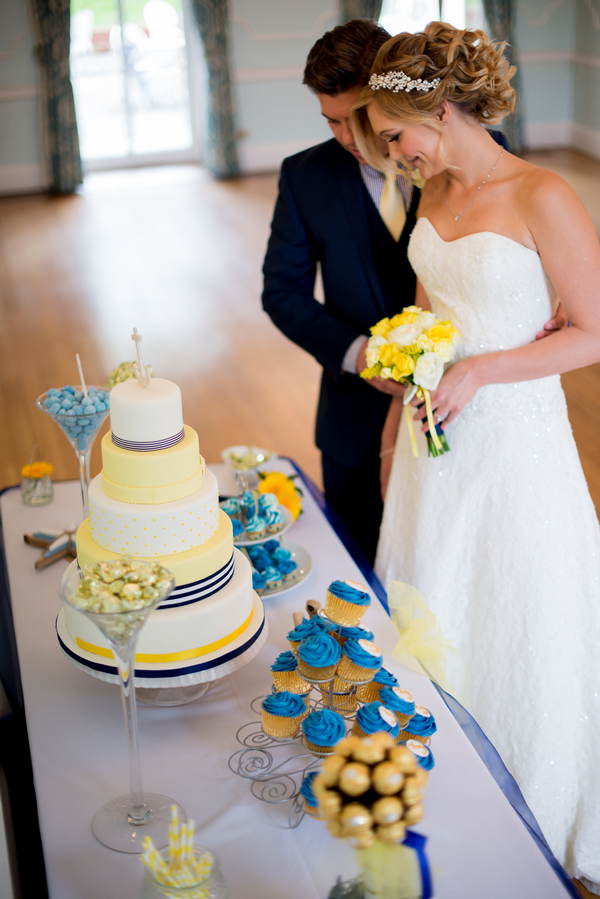 Bride and groom at cake table