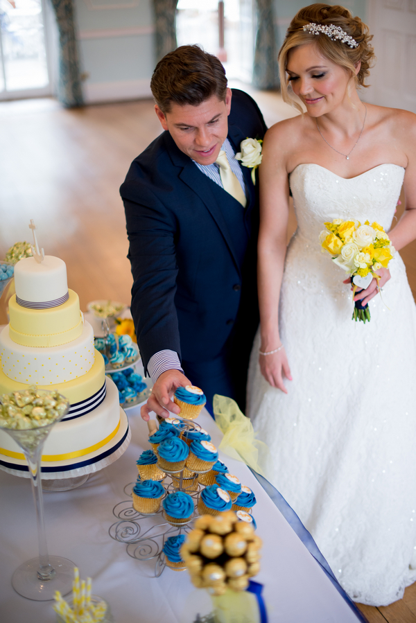 Groom taking cupcake