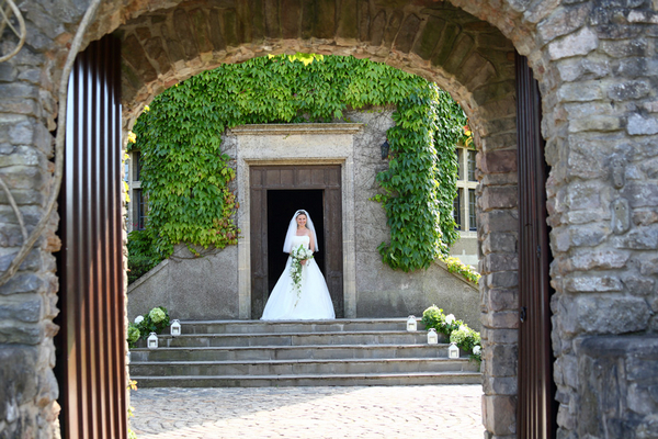 Bride on steps at Walton Castle
