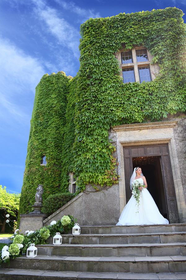 Bride on steps at Walton Castle