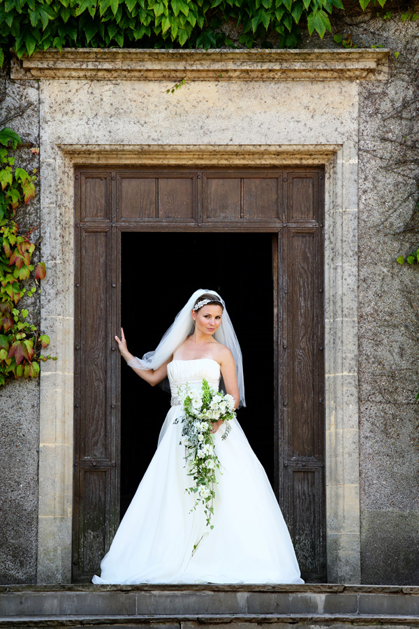 Bride standing at door of Walton Castle