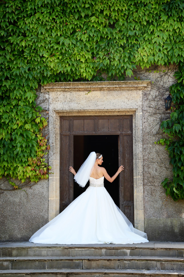 Bride standing in doorway of Walton Castle