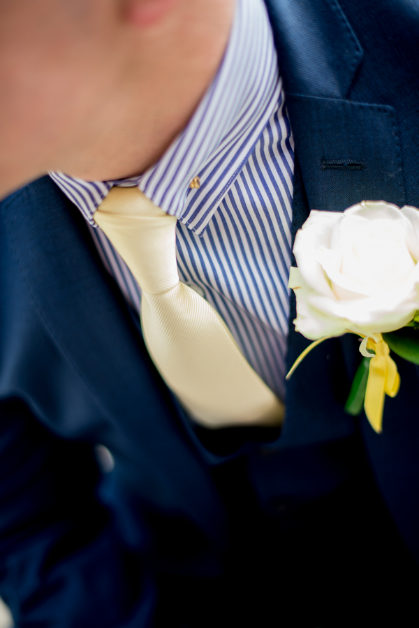 Groom's yellow tie and buttonhole