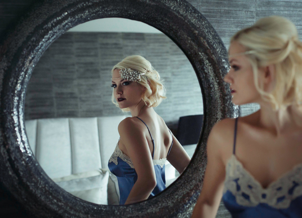 Woman in underwear looking in mirror - Bridal boudoir shoot