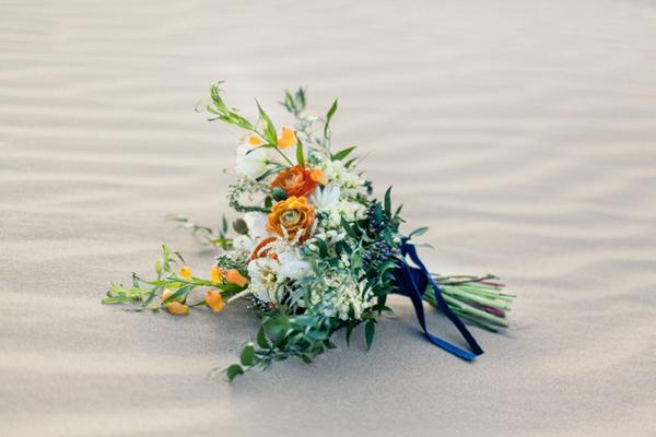 Bridal bouquet on sand in desert