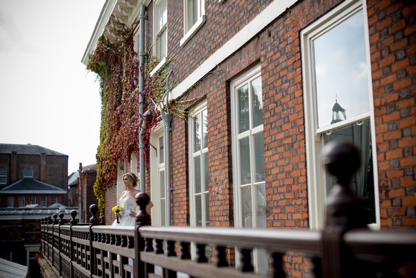 Bride standing on balcony