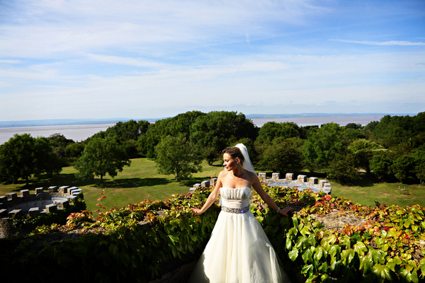 Bride standing in front of view from Walton Castle