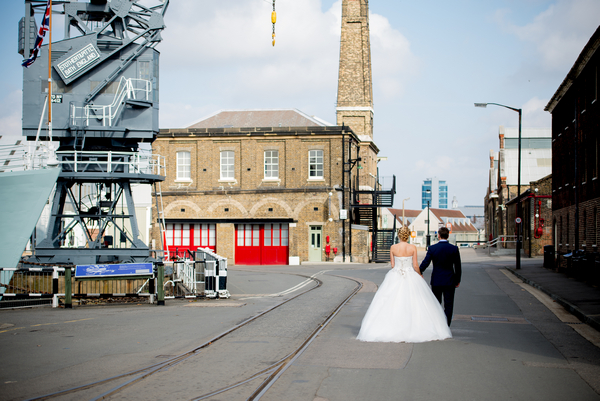 Bride and groom walking through The Dockyard Chatham