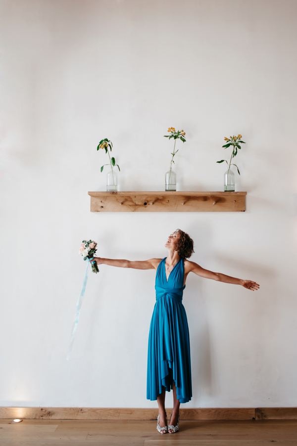 Bridesmaid holding arms out