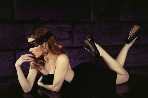 Blindfolded woman laying on front - Bridal boudoir shoot