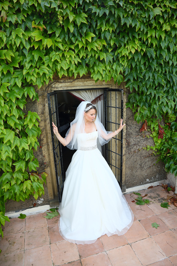 Bride standing on balcony at Walton Castle