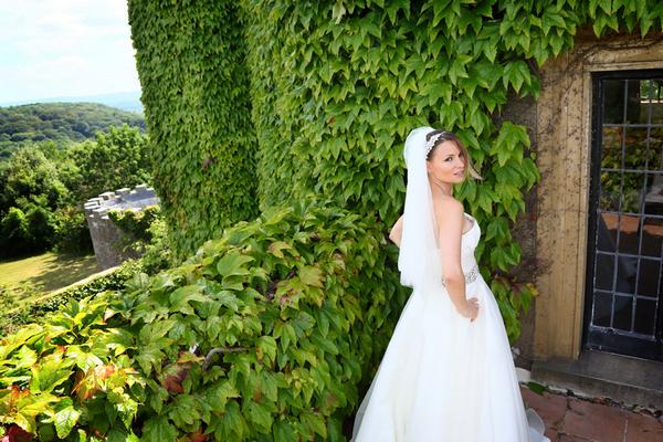 Bride standing on balcony at Walton Castle