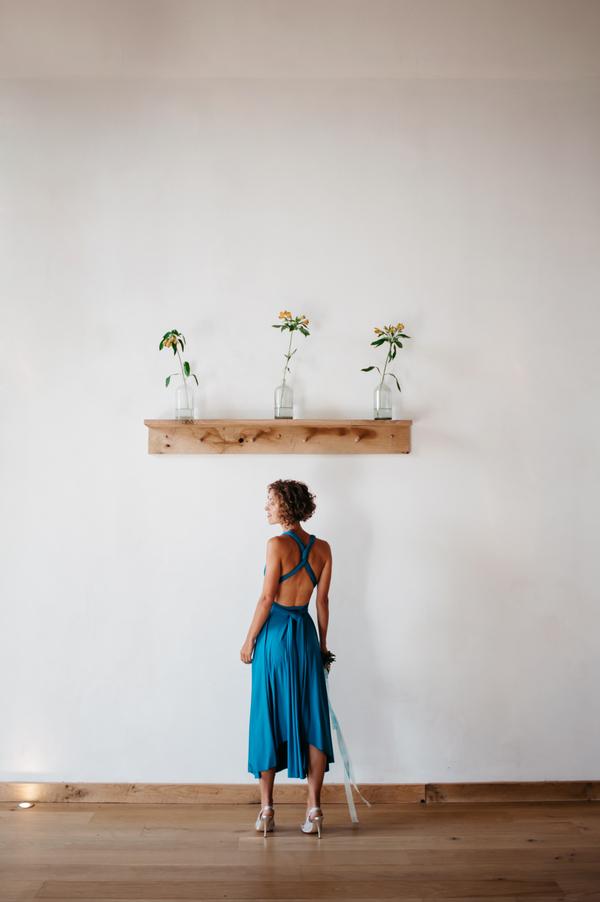Bridesmaid standing under shelf