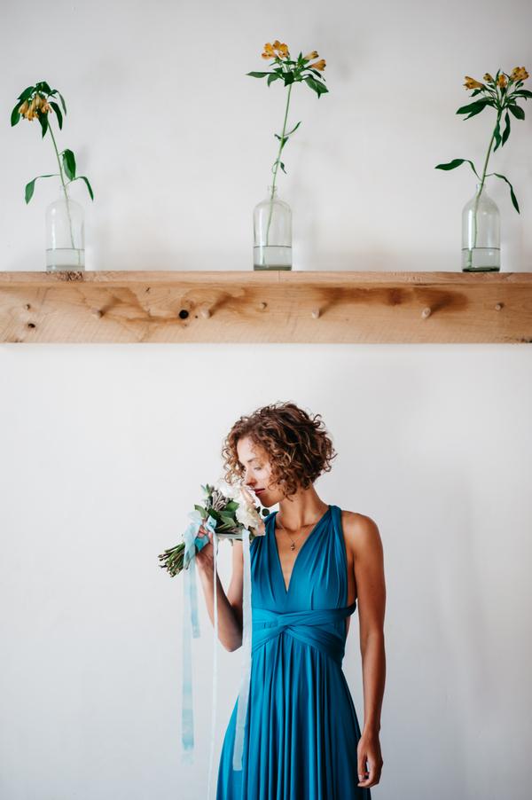 Bridesmaid smelling bouquet