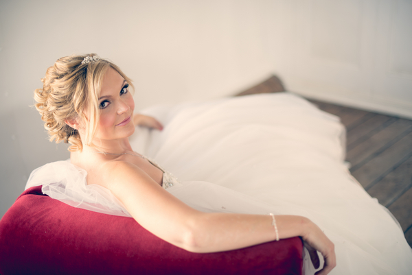 Bride leaning back on couch