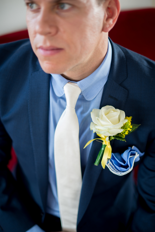 Groom's white tie and buttonhole