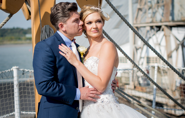Bride and groom on ship deck