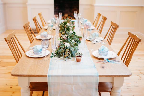 Wedding table with runner and foliage centrepiece
