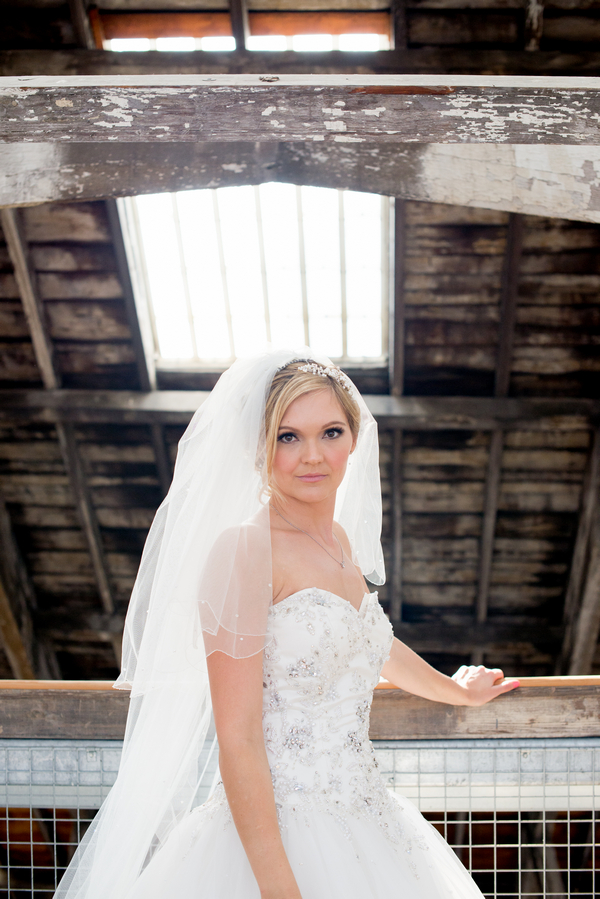 Bride leaning against beam