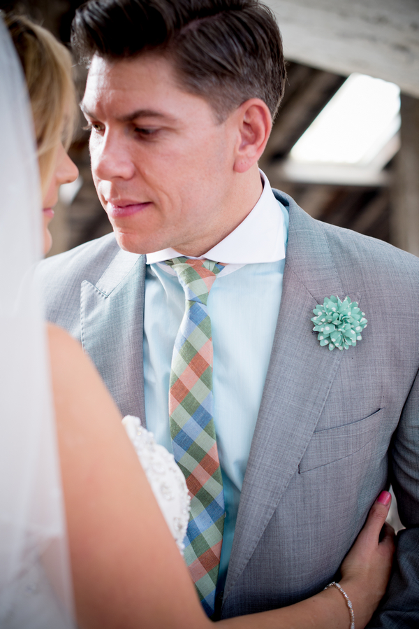 Groom with striped turquoise tie