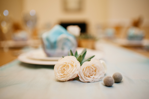 Flowers and pebbles on table