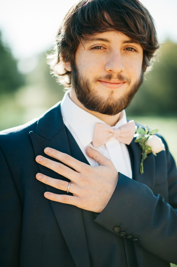 Groom with hand on chest