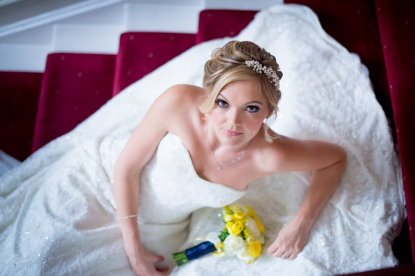 Bride laying on stairs