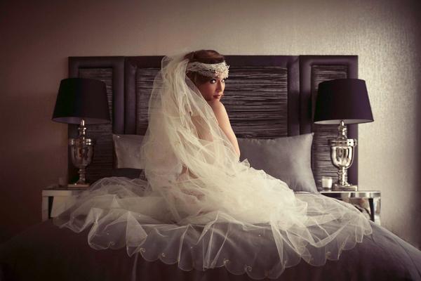 Bride in underwear and veil sitting on bed - Bridal boudoir shoot