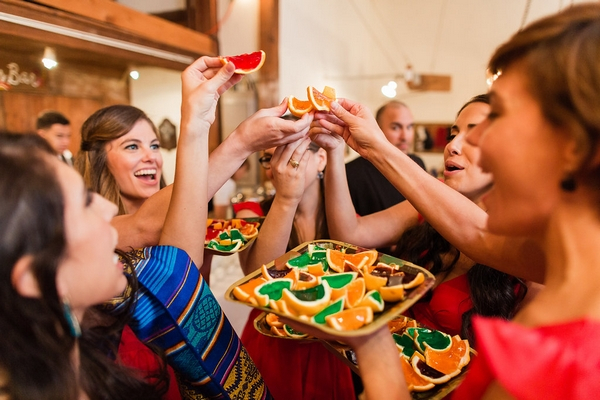 Wedding guests eating orange segments