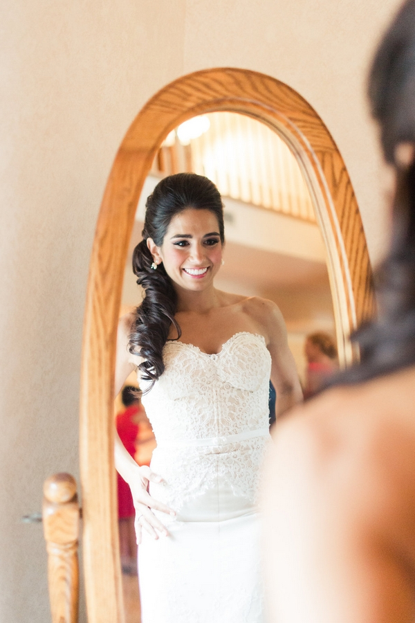 Bride looking in mirror