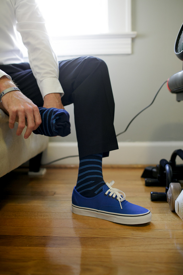 Groom putting on socks