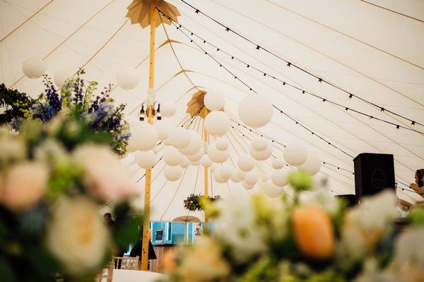 Globe lanterns hanging in PapaKata wedding tent