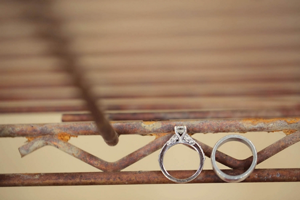 Wedding rings on rusty metal frame