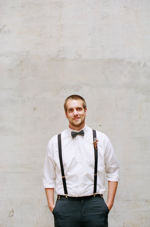 Groom with bow tie and braces