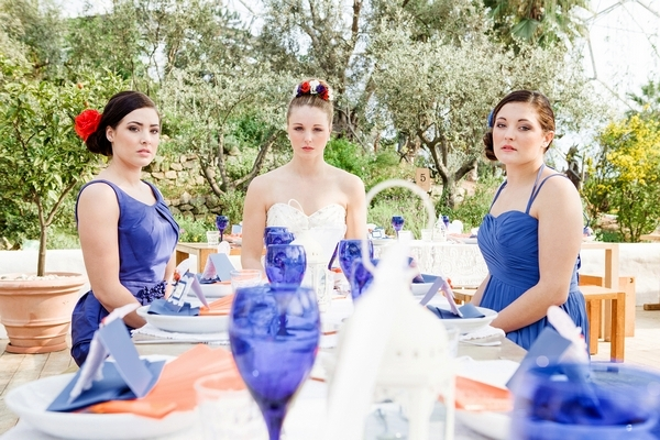 Bride and bridesmaids sitting at wedding table