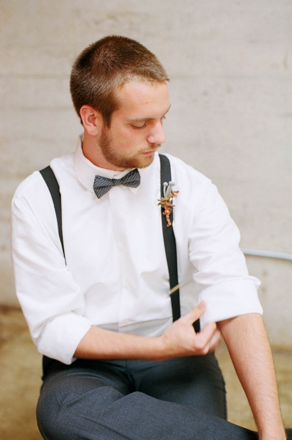 Groom rolling up sleeve