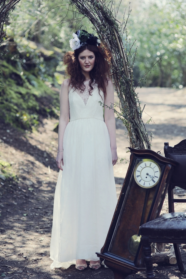 Bride standing next to grandfather clock