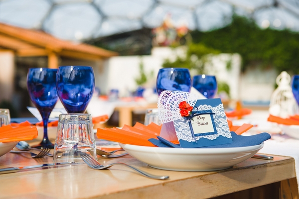Blue and orange wedding table decor