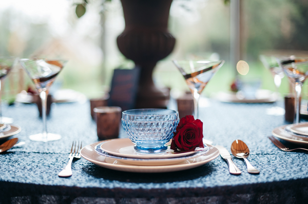 Blue glass bowl at wedding place setting
