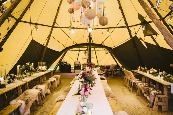 Wedding tables inside PapaKata Sperry tent