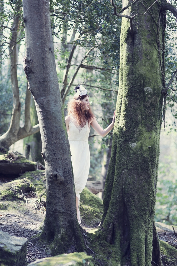 Bride standing in between trees