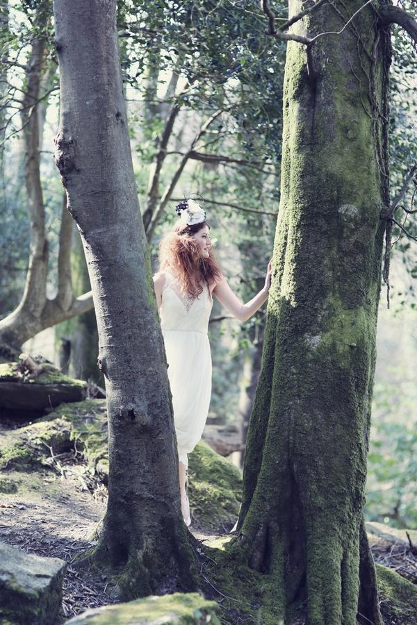 Bride standing in between trees